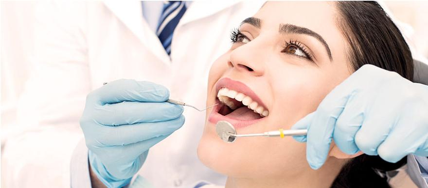 Picture of woman getting teeth cleaned